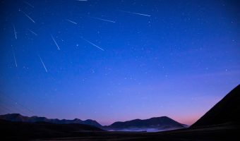multiple shooting stars in the night sky